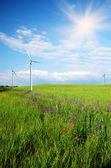 Wind turbines on green meadow — ストック写真