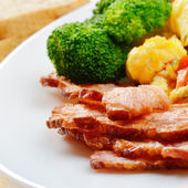 Omelette with vegetables and fried bacon — Stock Photo