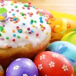 Stock Photo: Easter eggs and cake