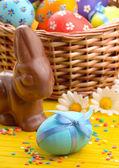 Easter eggs, cake, basket — Stock Photo