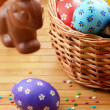 Stock Photo: Easter eggs, cake, basket