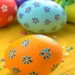 Easter decorations - eggs with painted flowers on the tabletop — Stock Photo