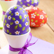 Hand crafted easter eggs on the wooden table — Stock Photo #18501391