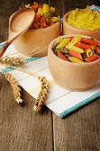 Raw tricolor pasta set on the wooden table — Stock Photo