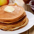 Delicious pancakes with butter and jam on the wooden kitchen  ta — Stock Photo