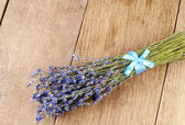 Lavender herb bunch on the oak table with copy-space — Stock Photo