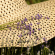 Summer hat with lavender flowers — Stock Photo