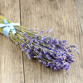 Lavender herb bunch on the oak table — Stock Photo