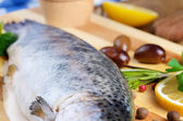 Raw trout on the board — Stock Photo