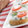 Royalty-Free Stock Photo: Cottage cheese bruschettas and vegetable basket