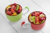 Cups with fruits — Stock Photo