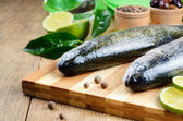 Raw trout on the cutting board — Stock Photo