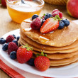 Stock Photo: Pancakes with berries and honey closeup