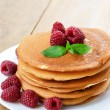 Ready to eat pancakes with raspberry — Stock Photo