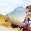 Happy driver woman shows thumb up — Stock Photo