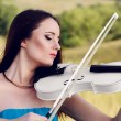 Young woman playing violin — Stock Photo