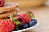 Pancakes with berries closeup — Stock Photo