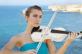 Young beautiful romantic woman with fiddle — Stock Photo