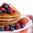 Pancakes with berries and honey over white — Stock Photo #38094293