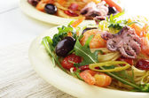 Seafood spaghetti pasta dish with octopus and shrimps — Stock Photo