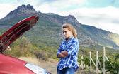 Young woman near broken car — Stock Photo