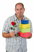 Man with gifts and rose — Stock Photo