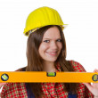 Craftswoman with hardhat and water level — Stock Photo #16181543
