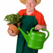 Senior gardener with flower pot — Stock Photo #16181855
