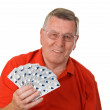 Senior man holding medicaments — Stock Photo #16699101