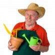 Senior gardener holding gardening tools — Stock Photo #19491561