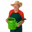 Old man holding watering can — Stock Photo #20322687