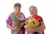 Senior women with fruit — Stock Photo