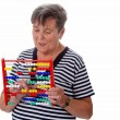 Senior woman with abacus — Stock fotografie