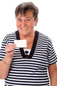 Senior woman holding a card — Stock Photo