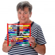 Senior woman calculating with abacus — Stockfoto