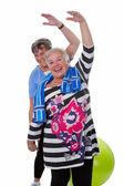 Two senior women doing gym exercises — Stockfoto