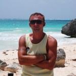 Man on the exotic beach — Stock Photo