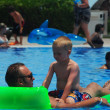 Stock Photo: Father and son in the pool