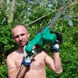 Man cutting a tree in the garden — Stock Photo #45869971