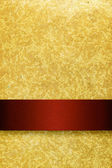 Gold background with rich red ribbon — Stock Photo