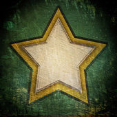 Star on dark grunge background — Стоковое фото