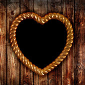 Złota rama w kształcie serca — Zdjęcie stockowe