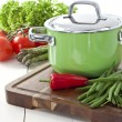 Green cooking pot and vegetables — Stock Photo