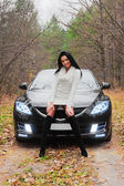 Beautiful woman and car — Stockfoto