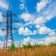 Stock Photo: High voltage lines and cloudy sky