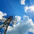 High voltage line and sun in the sky — Stock Photo