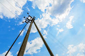 Powerline and cloudy sky — Stock Photo