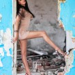 Beautiful woman in ruined building — Photo