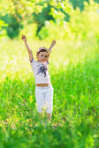 Young girl throwing her arms up — Stock Photo