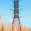 High voltage line and blue sky — Foto Stock